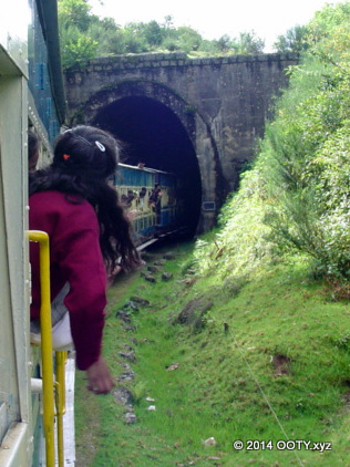 The Nilgiri Mountain Train passing through one of the many tunnels between Mettupaliayam and Coonoor